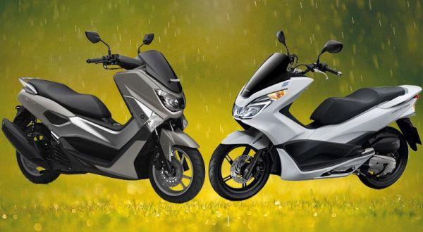 Yamaha NMax vs Honda PCX http://news.okezone.com/read/2015/01/27/15/1097729/yamaha-nmax-versus-honda-pcx-150
