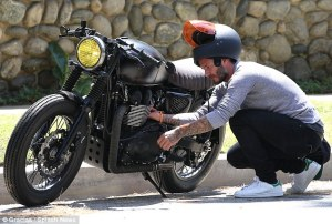 277BDDFF00000578-3035789-On_your_bike_David_Beckham_was_seen_checking_out_his_motorcycle_-a-68_1428849374460